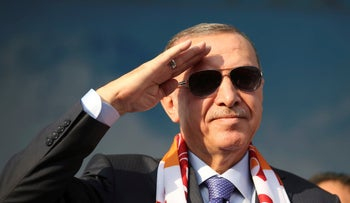Erdogan salutes supporters during a rally in Kayseri, Turkey, October 19, 2019.