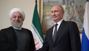 Iranian President Hassan Rohani with Russian counterpart Vladimir Putin in Yerevan, October 1, 2019.