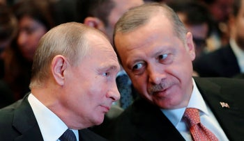 File photo: Russian President Vladimir Putin listens to Turkey's President Recep Tayyip Erdogan in Istanbul, November 19, 2018.