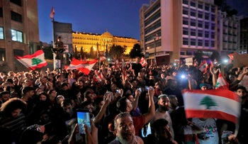 Lebanese protesters take to the streets during demonstrations to demand better living conditions and the ouster of a cast of politicians in Beirut, October 21, 2019.