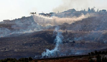 An Israeli firefighting plane extinguishing a fire at a village near Yitzhar, where Palestinian farmers were reportedly attacked by settlers, October 16, 2019.