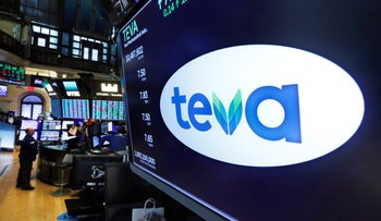 The logo for Teva appears above a trading post on the floor of the New York Stock Exchange, October 21, 2019.