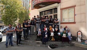 Protesters outside the local headquarters of Pro-Kurdish Peoples' Democratic Party (HDP) in Diyarbakir, Turkey, October 17, 2019.