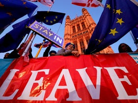 Battling Brexit and anti-Brexit signs outside the Houses of Parliament in London on October 22, 2019, as MPs debate the second reading of the Government's European Union (Withdrawal Agreement) Bill