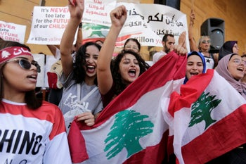 Anti-government protesters shout slogans against the Lebanese government in Beirut, Lebanon, October 22, 2019.