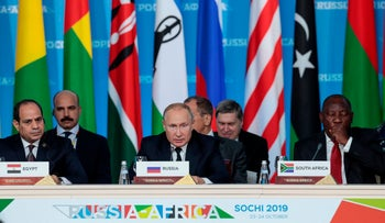 Egypt's Abdel Fattah al-Sisi (L), Russia's Vladimir Putin (C) and South Africa's Cyril Ramaphosa (R) attend the first plenary session as part of the Russia-Africa Summit, Sochi, October 24, 2019.