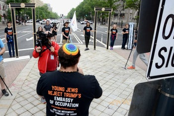 Members of IfNotNow and rabbinical school students blocking traffic while protesting President Donald Trump's U.S. Embassy move to Jerusalem and Israeli violence against Palestinians in Gaza, Washington, May 14, 2018.