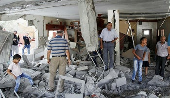 Palestinians inspect the home of the Abu Jaber family that was demolished by the Israeli military in east Jerusalem, October 6, 2015.