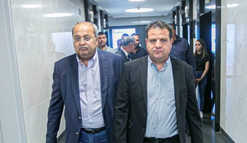 Joint List MKs Ayman Odeh and Ahmad Tibi arrive at a meeting in Bnei Berak, October 10, 2019.