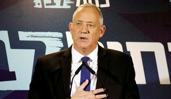 Benny Gantz, leader of Israel's Blue and White party, gestures as he delivers a statement before his party faction meeting in Tel Aviv, Israel September 19, 2019.