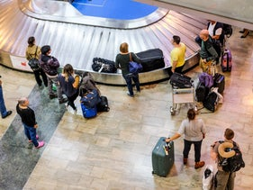 People waiting for their suitcases at Ben-Gurion International Airport.