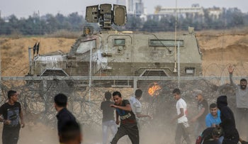 Palestinian protesters during clashes with Israeli forces in the southern Gaza strip on October 25, 2019.