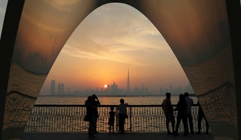 People enjoy a city skyline view with the World's tallest building Burj Khalifa, in Dubai, United Arab Emirates, October 2019.