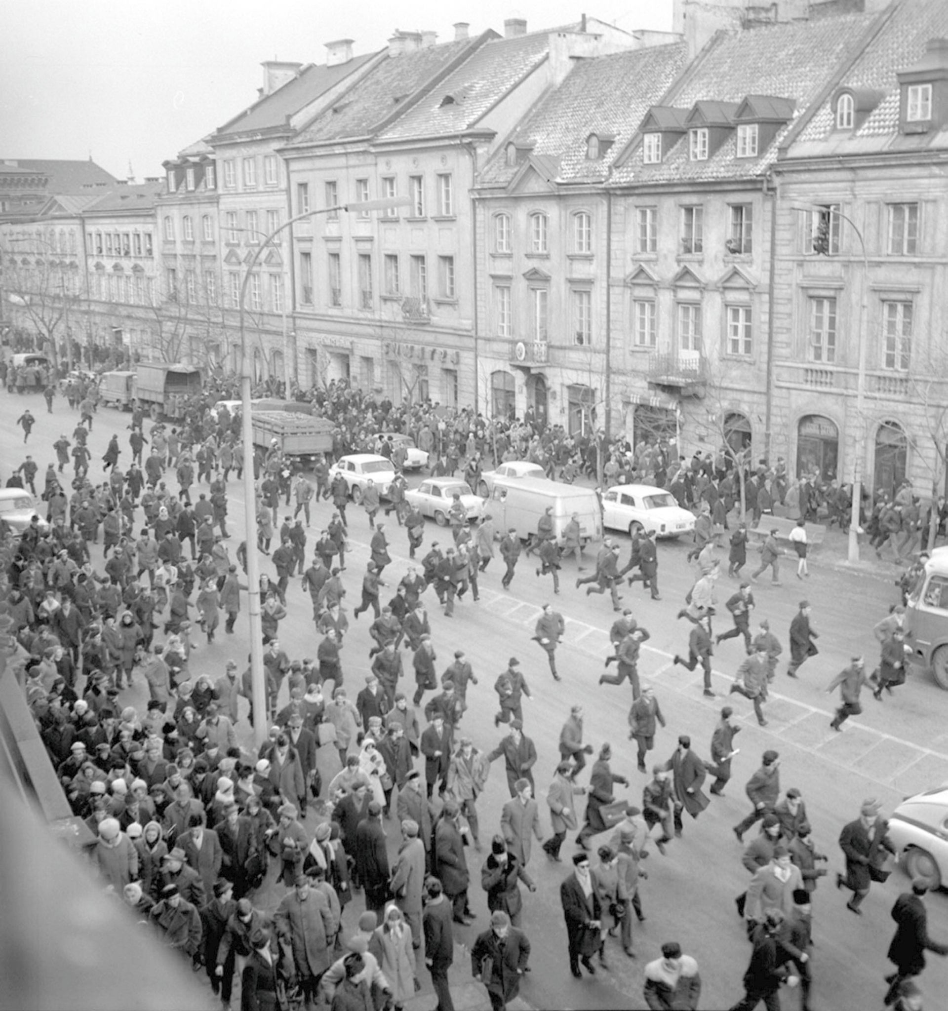 A March 1968 photo showing people running away as police attack near the Warsaw University during student riots.