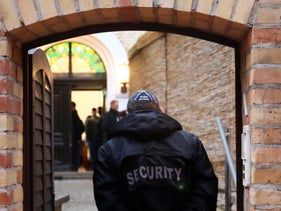 ILLUSTRATION: A security officer walks into a synagogue