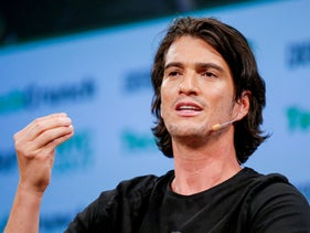 Adam Neumann, former CEO of WeWork, speaks to guests during the TechCrunch Disrupt event in New York City, May 15, 2017.