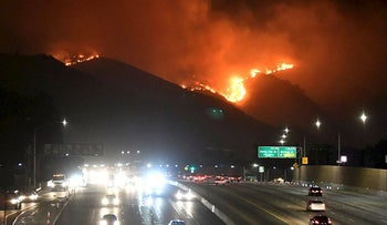 The Getty Fire burns next to the 405 freeway in the hills of West Los Angeles, California, U.S. October 28, 2019