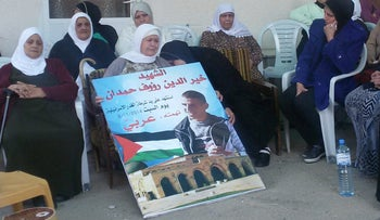 Family of Kheir Hamdan, on the poster, mourning following his death in a police operation, November 8, 2014