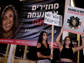 Israelis hold signs calling for the release of Israeli Naama Issachar during a demonstration In Tel Aviv, Israel, Saturday, October 19, 2019.