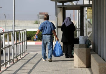 Palestinians at the Erez crossing on the Gaza border.