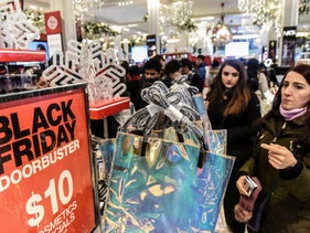 People shop during a Black Friday sales event at Macy's flagship store on 34th St. in New York City, U.S., November 22, 2018.