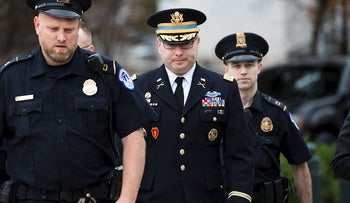 Army Lieutenant Colonel Alexander Vindman, a military officer at the National Security Council, center, arrives on Capitol Hill in Washington, Tuesday, Oct. 29, 2019