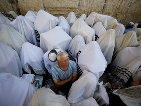 Jewish worshippers taking part in the priestly blessing during Sukkot at the Western Wall in Jerusalem's Old City, October 16, 2019.