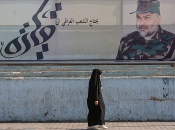 """""""The Iraqi people need leadership"""" : A poster of Iraqi Shiite cleric and political leader Moqtada al-Sadr wearing military fatigues, Baghdad, October 24, 2019"""