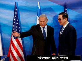 Prime Minister Benjamin Netanyahu gestures while standing next to U.S. Treasury Secretary Steven Mnuchin as they prepare to deliver joint statementsת Jerusalem October 28, 2019.
