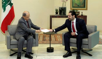 Lebanese President Michel Aoun (L) receives a letter of resignation from PM Saad Hariri, October 29, 2019