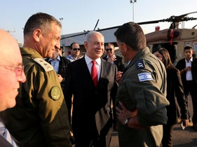 Prime Minister Benjamin Netanyahu, Chief of Staff of the Israel Defence Force Aviv Kohavi and commander of the Israeli Air Force Amikam Norkin at the Palmachim Air Force Base, October 27, 2019.