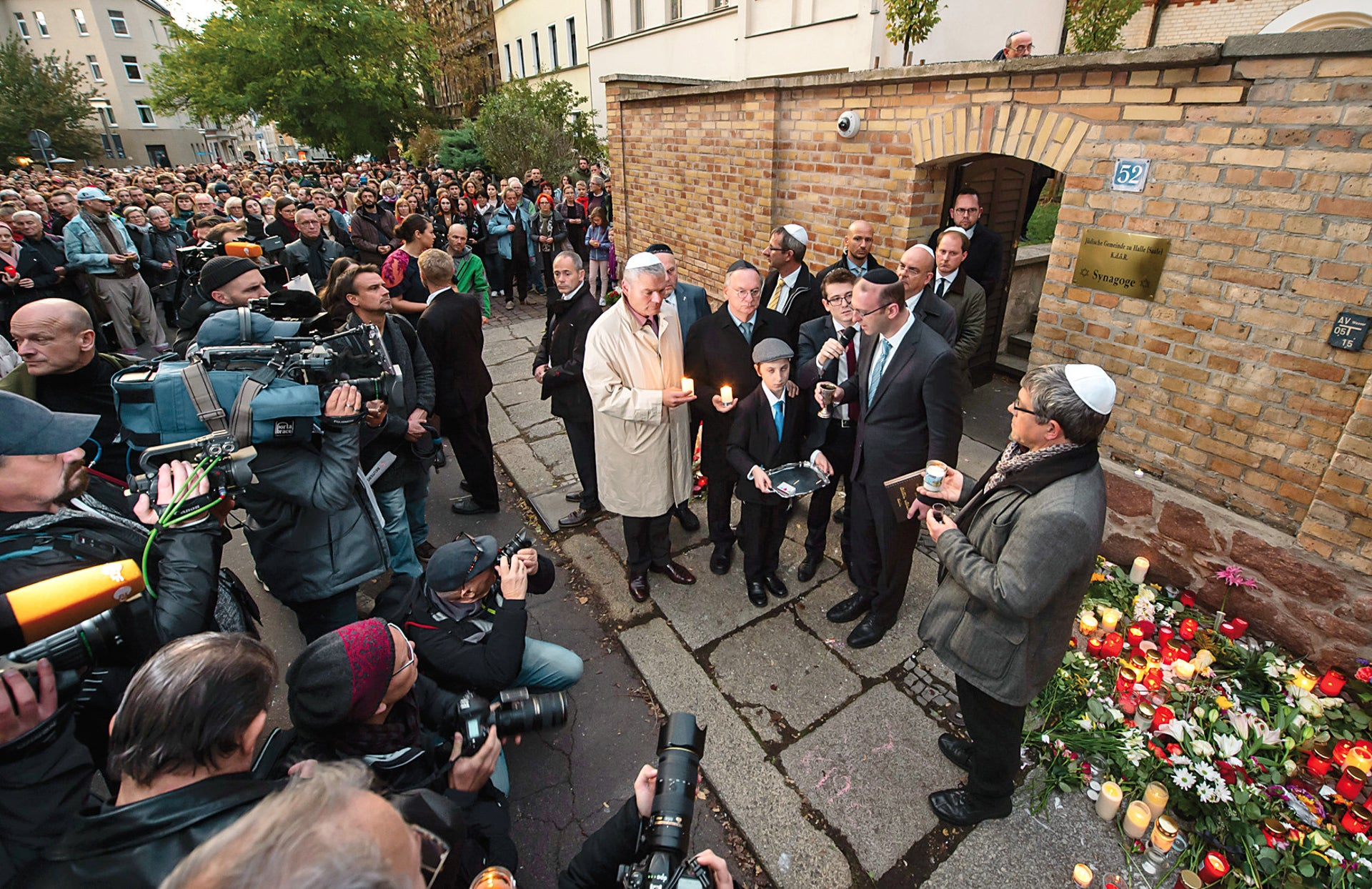 A community prayer session outside the synagogue in Halle, Germany, where a right-wing extremist launched an attack on Yom Kippur, killing two.