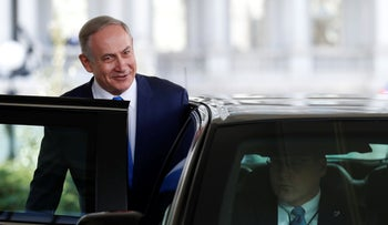 Israeli Prime Minister Benjamin Netanyahu smiles as he gets into his car as he leaves the West Wing of the White House in Washington, February 15, 2017.