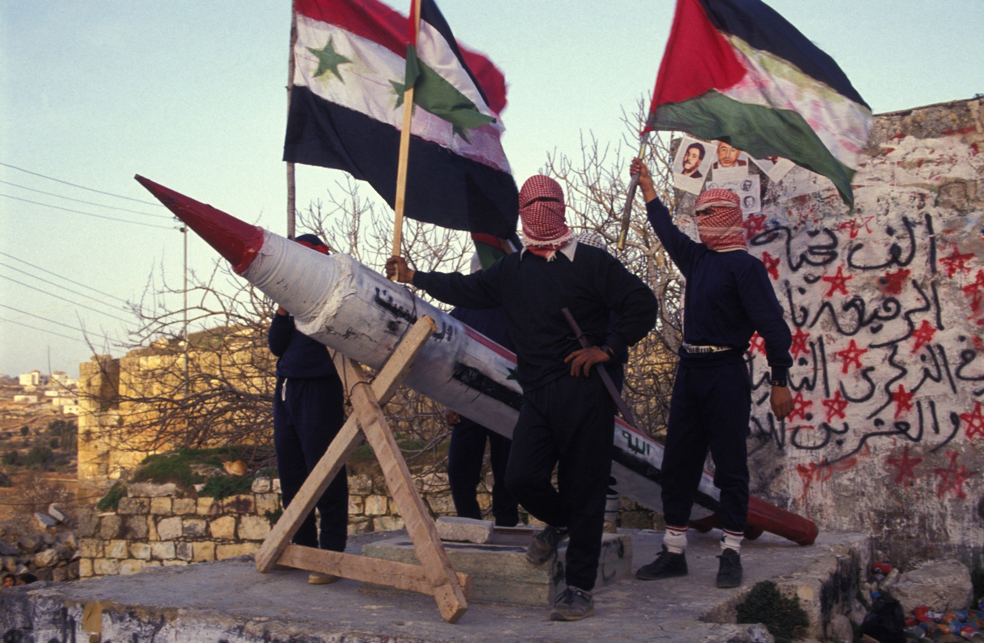 Palestinians express support for Saddam Hussein during the Gulf War, in the West Bank, 1991.