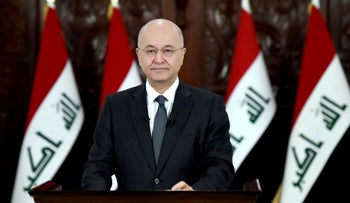 Iraq's President Barham Salih delivers a televised speech to people in Baghdad, October 31, 2019.