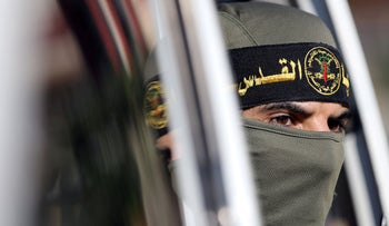 A Palestinian Islamic Jihad militant looks out of a vehicle during a military show in the Gaza Strip on October 3, 2019.