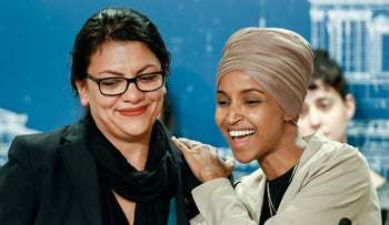 U.S. Representatives Rashida Tlaib and Ilhan Omar react as they discuss travel restrictions to Palestine and Israel during a news conference in St Paul, Minnesota, August 19, 2019.