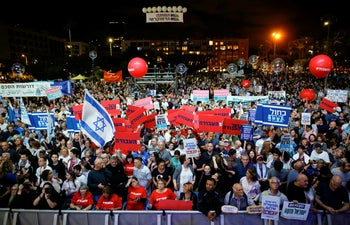 People attend a rally commemorating the 24th anniversary of the assassination of Israeli Prime Minister Yitzhak Rabin, in Tel Aviv, Israel November 2, 2019.