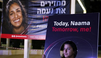 An Israelis woman demonstrates on October 19, 2019 in the coastal city of Tel Aviv to support the case of Naama Issachar, a 26-year-old Israeli sentenced to seven-and-a-half years in jail by a Russian court on October 11.