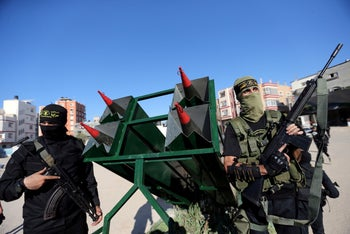 Palestinian Islamic jihad militants display rockets during a military show marking the 32nd anniversary of the organisation's founding, in the central Gaza Strip October 3, 2019.
