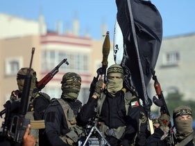 Palestinian Islamic jihad militants take part in a military show marking the 32nd anniversary of the organisation's founding, in the central Gaza Strip. October 3, 2019