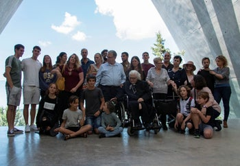 Melpomeni Dina, center right, poses for a group photo during a reunion at the Yad Vashem Holocaust memorial in Jerusalem, November 3, 2019.