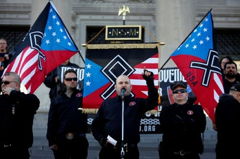 Jeff Schoep, former chairman of the National Socialist Movement, speaks during a rally at the state capitol in Little Rock, Arkansas, U.S., November 10, 2018
