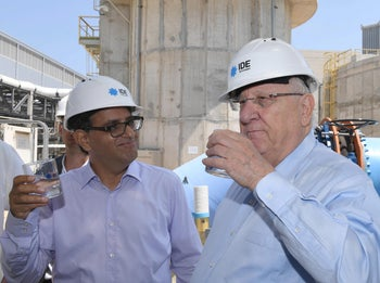 President Rivlin about to drink some water at IDE's Soreq desalination facility, June 3, 2018