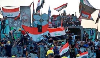 Anti-government protesters pictured in Baghdad last month.