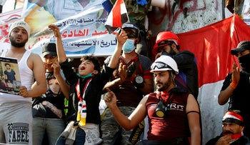 Iraqi demonstrators chant slogans during an ongoing anti-government protest, in Baghdad, Iraq, November 5, 2019.