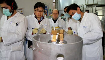 IAEA inspectors and Iranian technicians photographed at the Natanz enrichment plant in 2014.