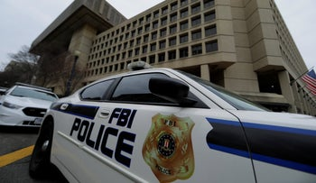 FILE PHOTO: FBI police vehicles sit parked outside of the J. Edgar Hoover Federal Bureau of Investigation Building in Washington, U.S., February 1, 2018.