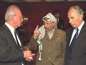 Then-Israeli Prime Minister Yitzhak Rabin, PLO Chairman Yasser Arafat and Israeli Foreign Minister Shimon Peres talking after they were awarded the Nobel Peace Prize in Oslo, 1994