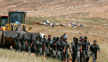 File photo: Israeli border police officers seen near the site of the Maoz Esther outpost after in the northern West Bank, May 2009.